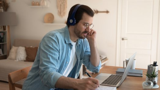 man on computer taking online bible courses
