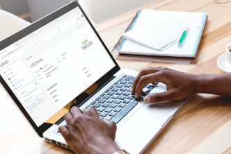 Image of man on computer for a post about how to set up online giving at your church