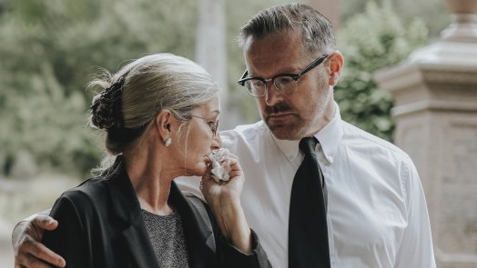 Pastor caring for a grieving woman for a post about pastoral empathy