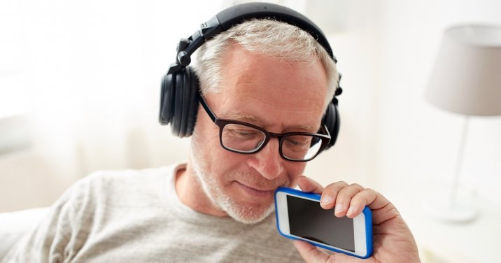 Image of a man listening to a podcast for faithlife Bible podcast post