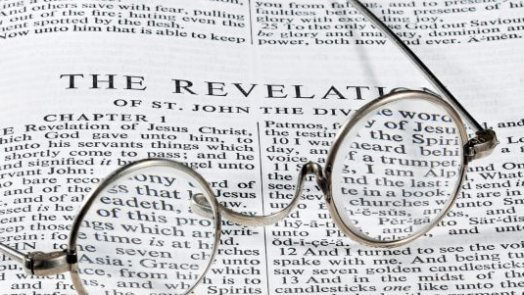 Bible open to the book of revelation